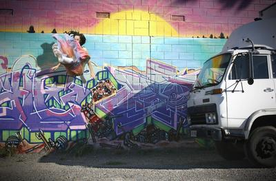 Emily Button Falling Beside a Truck ART LOGIC