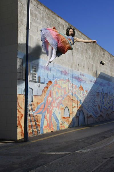 Emily Button Floating Past Graffiti ART LOGIC