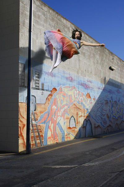 Emily Button Floating Past Graffiti ART LOGIC